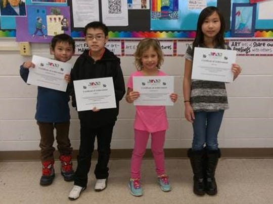 Artwork by Weston Elementary students, from left, Kong Chor Meng Thao, Quan Lor, Leah Camarato and Julie Yang is on display until Feb. 24 at New Visions Gallery in Marshfield. Peytton Reinicke, missing from photo, also will have work in the exhibit.