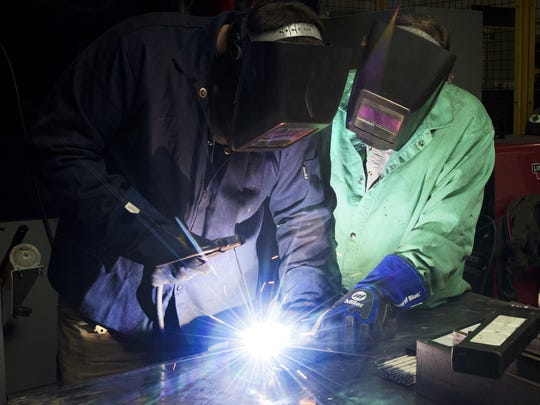 Maintenance Intern Mason Pierce, left, gets training from L.D. Harrison at the Hyundai plant in Montgomery, Ala. on Friday August 21, 2015. Hyundai is continuing and expanding a training partnership with Trenholm Tech.