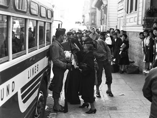 """A busload of """"evacuees"""" on April 29, 1942, prepares to depart from a """"civil control station"""" in San Francisco. This photo is featured in an exhibit on Japanese internment at the FDR Presidential Library and Museum in Hyde Park."""