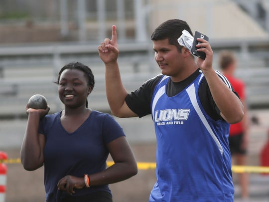 Manuel Aramburo celebrates his win in the shot put during the DVL field event finals at Palm Desert High School, April 30, 2018