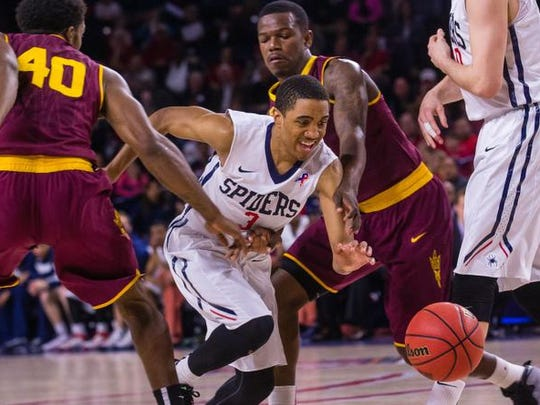 Richmond guard ShawnDre' Jones, center, chases a loose ball during the first half of an NCAA college basketball game during the NIT tournament at Robins Center in Richmond, Va., on Sunday, March 22, 2015.