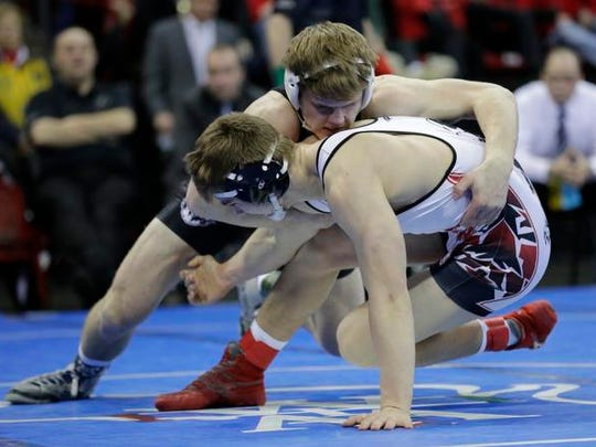 Random Lake High School's Helton Vandenbush, back, wrestles Iowa-Grant/Highland's Brady Peat in their 170-lb WIAA Division 3 championship match during the 2017 Individual Wrestling State Tournament Saturday, Feb. 25, 2017, at the Kohl Center in Madison, Wis.Dan Powers/USA TODAY NETWORK-Wisconsin