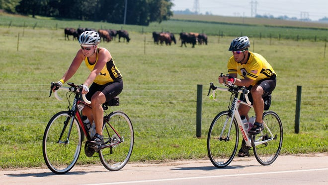 Riders make their way along the route to Terry Trueblood Park as part of the Gran Gable bike ride on Sunday, August 31, 2014. The fondo offered a choice of 25, 60, or 100 mile loops that showcased the partnership between Coach Gable, the Iowa City/Coralville Area Convention & Visitors Bureau, the Iowa Bicycle Coalition, and RAGBRAI. All proceeds from the granGABLE fondo will benefit the Iowa Bicycle Coalition and Hawkeye Wrestling Club.