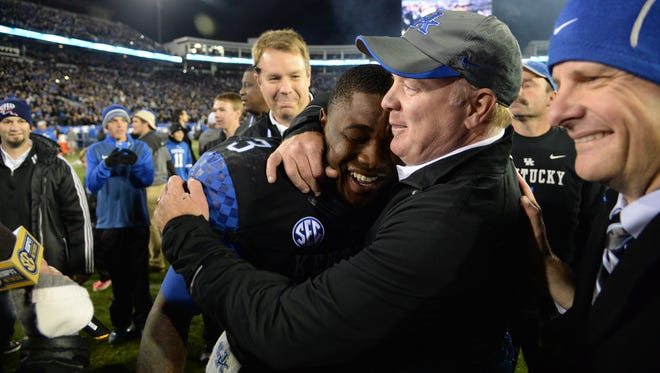 UK RB Jojo Kemp is hugged by head coach, Mark Stoops, after the University of Kentucky Wildcats Football game against the South Carolina Gamecocks in Lexington, KY. Saturday, October 4, 2014.