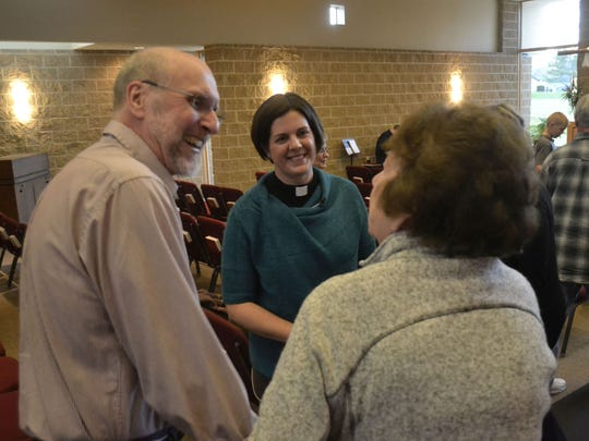 The Rev. Jennifer Fite, middle, exchanges peace with parishioners Kevin Butch, left, and Connie Horen during service at Good Shepherd Lutheran Church in Howard on Monday night, May 2, 2016. Fite is in her first year as pastor at Good Shepherd.