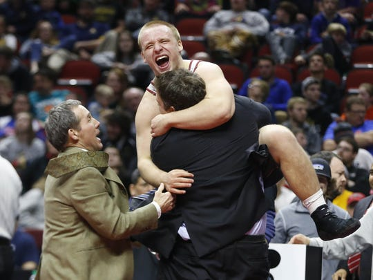 Newman Catholic's Colton Hansen celebrates his 220-pound