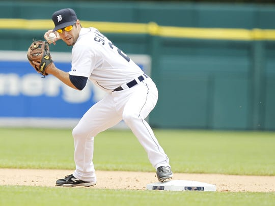 Detroit Tigers  2nd baseman Scott Sizemore starts to turn a double play to end the 2nd inning with a 2-0 led against the Tampa Bay Rays in Detroit, Michigan, on Wednesday, May 25,  2011.