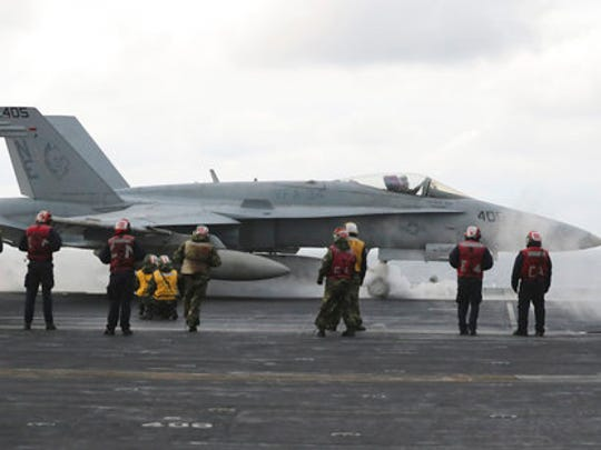 FILE - In this March 14, 2017 file photo, an F/A-18 fighter prepares to take off from the deck of the Nimitz-class aircraft carrier USS Carl Vinson during the annual joint military exercise called Foal Eagle between South Korea and the United States at an unidentified location in the international waters, east of the Korean Peninsula. North Korea is vowing tough counteraction to any military moves that might follow the U.S. Navy's decision to send the USS Carl Vinson aircraft carrier and its battle group to waters off the Korean Peninsula.
