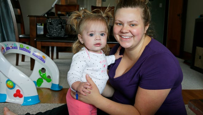 Chelsea Barlow plays with her daughter Addyson at their home in Racine. Addyson had a mysterious illness that was only diagnosed and treated through the use of DNA sequencing.