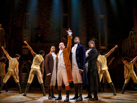 """Joseph Morales (center) plays Alexander Hamilton in the touring Broadway production of """"Hamilton"""" at Greenville's Peace Center through Dec. 16."""