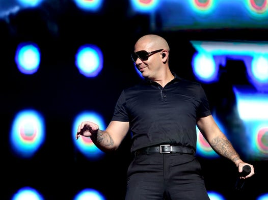 Pitbull performs in the Coliseum at the Indiana State Fair in Indianapolis on Friday, Aug. 8, 2014.