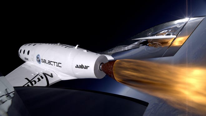 Virgin Galactic's first SpaceShipTwo during its third, successful powered flight. The vehicle broke apart during its fourth powered flight last October.