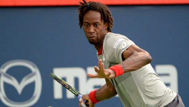 Aug 10, 2015; Montreal, Quebec, Canada;  Gael Monfils of France hits the ball against Fabio Fognini of Italy (not pictured) during the Rogers Cup tennis tournament at Uniprix Stadium.
