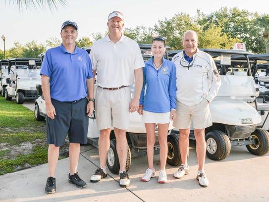 Chris Robertson, left, Joey Trefelner, and Gina and