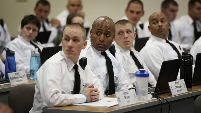 Columbus police recruits, such as these seen here in 2018 in a classroom at the Columbus Police Academy, face extensive investigation into their backgrounds and associations. But once an officer is on the force, the city has less leverage in trying to find out about associations with hate groups.