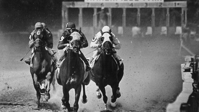 Horses zip down the home stretch at Marshfield Fair in 1983.