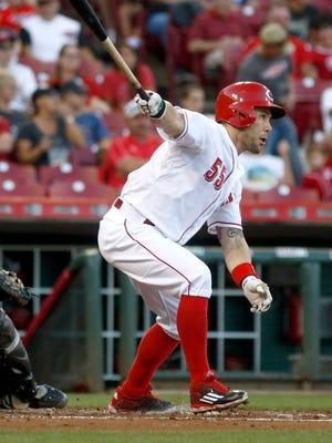 Cincinnati Reds left fielder Skip Schumaker (55) hits a double against the Arizona Diamondbacks in the second inning.