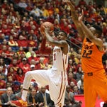 Iowa State's Monte Morris drives the lane against Oklahoma State on Jan. 6, 2015, at Hilton Coliseum in Ames.