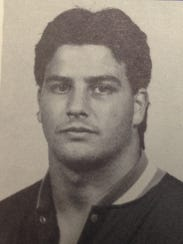 R.J. Costello wrestled for West Virginia University and later became a high school wrestling coach before moving into athletic administration.