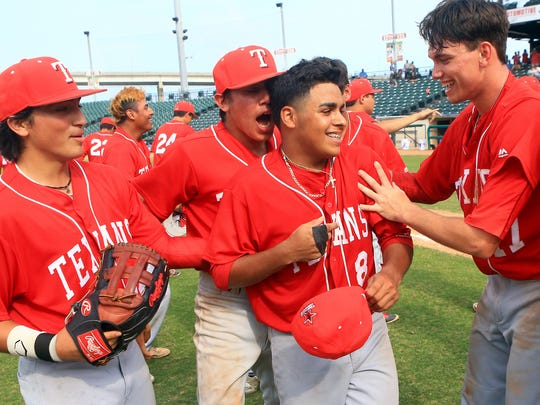 Ray players celebrate with Isaac Flores after defeating Calallen 3-0 in game 3 of the Class 5A regional quarterfinals series on Saturday, May 20, 2017, at Whataburger Field in Corpus Christi.