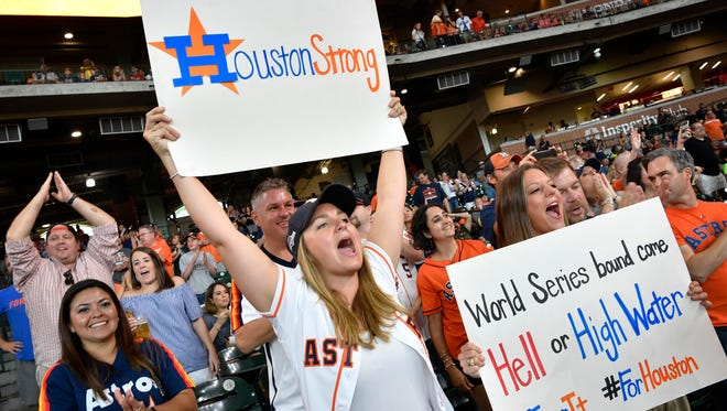 Trish Huddleston and Allie Coogan came out to show their support for their city and their team as the Astros played the Mets in a double header in Houston on Sept. 2, 2017,  in the first big event after the area was deluged with catastrophic flooding.  'We just needed a diversion after all that's happened' Huddleston said.