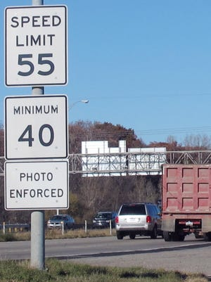 A highway sign along Interstate 380 in Cedar Rapids, Iowa, warns drivers that the 55-mph speed limit is enforced by speed cameras.