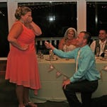 """Iowan """"Megan"""" gets proposed to by her longtime boyfriend at her sister's wedding. A Reddit post featuring the picture whipped commenters into a frenzy."""