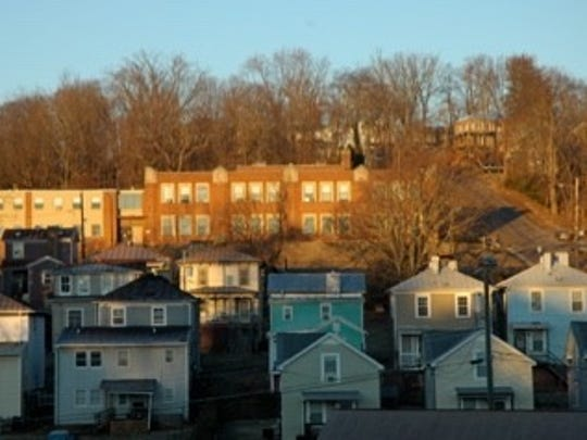 Photograph taken at dawn of Booker T. Washington High School and the surrounding neighborhood from Johnson and Fayette Streets.