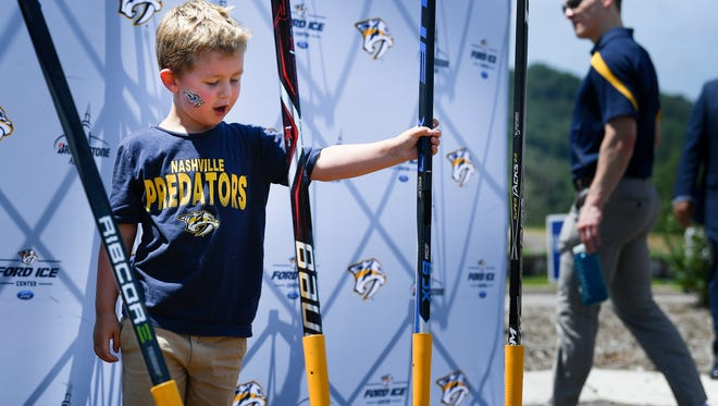 Blake Butler 4, checks out the shovels at the ground breaking for the new Preds Ice Center at One Bellevue Place Friday, June 29, 2018, in Nashville, Tenn.