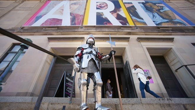 Neal Bourbeau, coordinator for education, wears a reproduction of a suit of armor representing the time period of about 1470, on Thursday, as Worcester Art Museum opened its doors  to members.