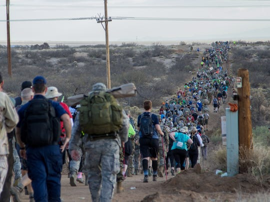 Marchers pass the first water station on the 29th Bataan Memorial Death March trail at White Sands Missile Range early Sunday, March 25, 2018.