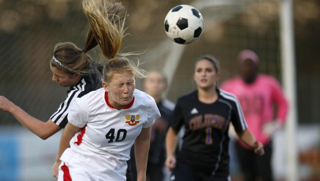 Leon sophomore Kate Carter heads the ball against Columbia during their District 2-4A semifinal game at Chiles High School on Wednesday. Carter scored two goals and the Lions won 4-0.