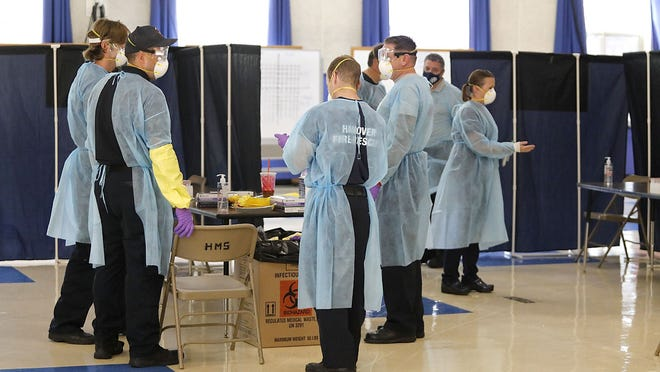 Hanover firefighters and school nurses test school employees for COVID-19 Sept. 14, as part of the fire department's Mobile Integrated Health program. That testing, which recently identified three cases, continues for students, staff and family as the schools remain open.