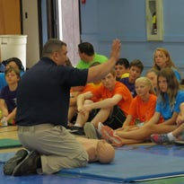 The 13th annual Camp R & R had 50 Grand Isle County middle school students learn first aid skills, including certification in CPR and training in AED.
