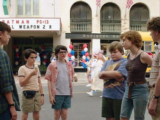 """Jaeden Lieberher (from left), Jack Dylan Grazer, Finn Wolfhard, Jeremy Ray Taylor, Sophia Lillis, Wyatt Oleff and Chosen Jacobs star in """"It."""""""