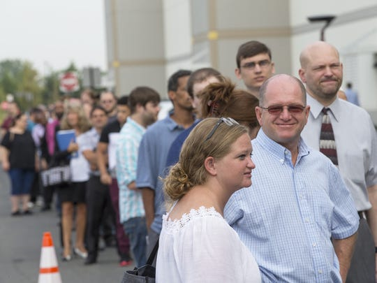 Thousands of people wait in line to apply for an Amazon