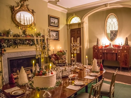 The dining room at Boscobel is decorated for the season, using garlands, candles and confections.
