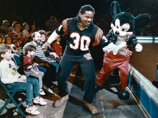 The Bengals Ickey Woods shows Mickey Mouse how to dance the Ickey Shuffle on Jan. 13, 1989, at Walt Disney's World on Ice at Riverfront Coliseum.