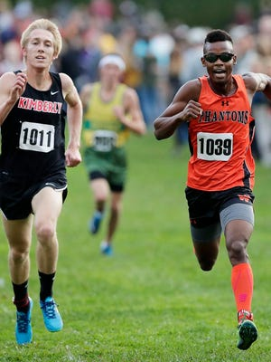 West De Pere's Jermaine Evans leads Kimberly's Jack Fitzgerald to the finish at the Division 1 WIAA boys cross country sectional meet at Colburn Park on Friday, October 20, 2017 in Green Bay, Wis.