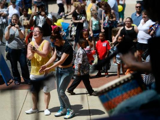 Mary Cabrera and her niece, Angelica Cabrera, both of York, dance as B-Tropical plays in front of the York County Administrative Building on East Market Street during the 40th annual Olde York Street Fair in York on Sunday.