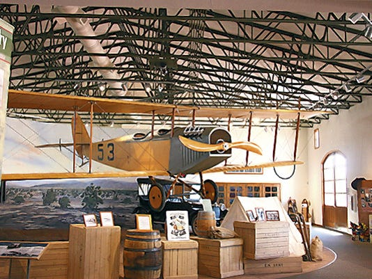 """A flying Jenny hangs above the Pancho Villa Exhibition Hall in Columbus. The Jenny airplanes were first used by the U.S. Army Air Corps during the Punitive Expedition in the hunt for Mexican Gen. Francisco """"Pancho"""" Villa. The park offers history, camping and close proximity to the colorful border communities of Columbus and Palomas, Mexico."""