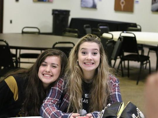 North Farmington sophomore Lynn Lerner (left) and senior