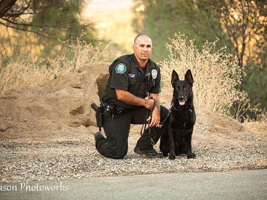 Officer Ryan Ellis and police canine Tarro