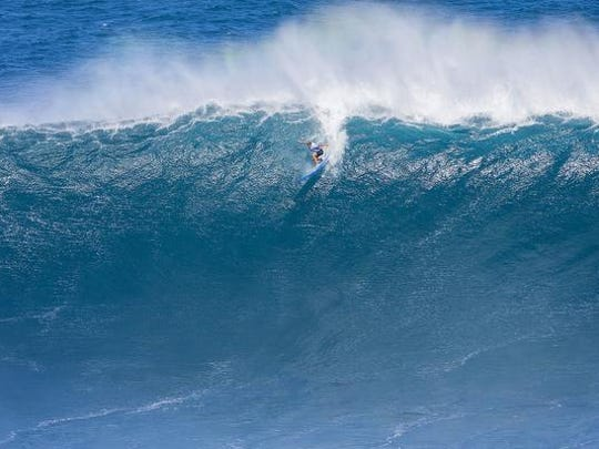 "In a photo provided by the World Surf League, Emi Erickson surfs a Maui surf break known as ""Jaws"" on Friday, Nov. 11, 2016, in Haiku, Hawaii. Erickson is part of a group of women who made history Friday as they competed for the first time in the World Surf League's big-wave surfing competition."
