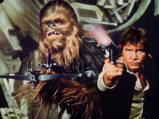 "Han Solo (Harrison Ford) and Chewbacca appear in ""Star Wars: A New Hope."""