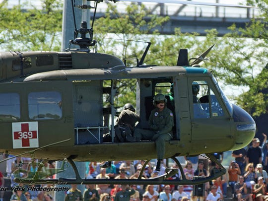 Huey 369, a restored Vietnam-era helicopter, lands during an event earlier this year.