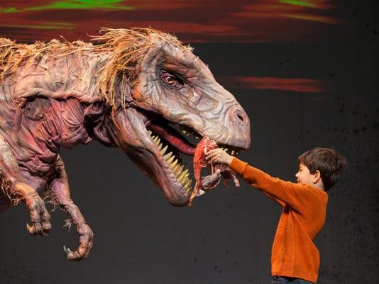 A feeding tyranasaurus rex.jpg