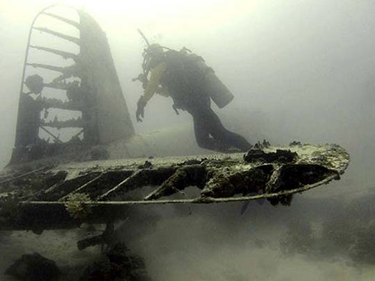 The missing Navy Hellcat Fighter plane that was discovered amid coral heads in Palau back in March.