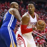 Houston Rockets center Dwight Howard (12) attempts to spin around Golden State Warriors center Marreese Speights in Game 3.