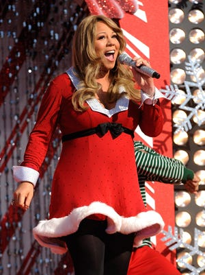 "Mariah Carey performs during a taping of the Disney Parks Christmas special in 2010. Her holiday hit ""All i Want for Christmas Is You"" keeps rising in popularity."